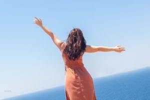Young girl enjoying vacation, sea and warm breeze, summer vacation